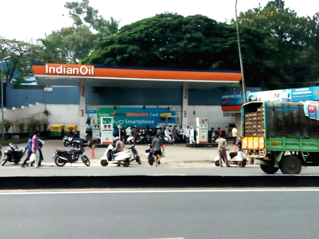 People wait outside a petrol bunk in Bengaluru on Sept 13, 2016.