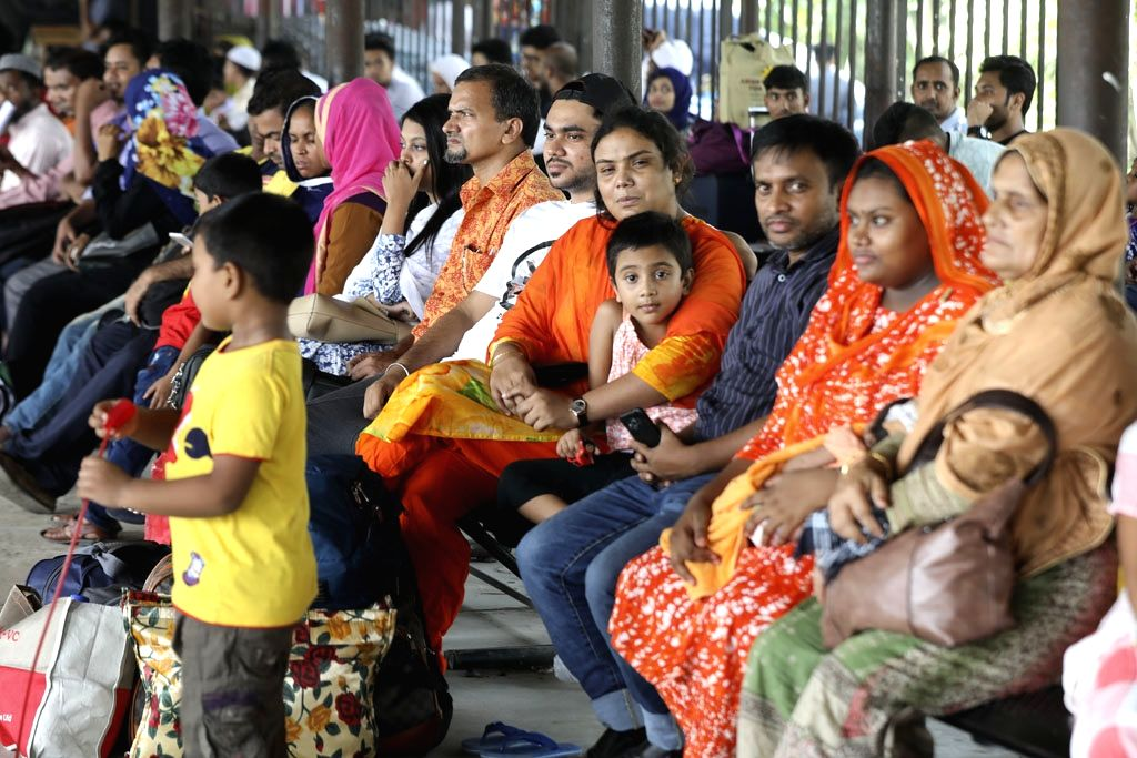 People wait to board a train as they leave for their home towns to celebrate Eid ahead of the festival, at Biman Bandar railway station in Dhaka, Bangladesh on May 28, 2019.