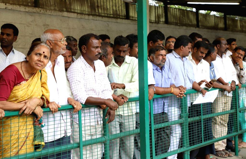 People wait to meet and share their grievances with Karnataka Chief Minister H.D. Kumaraswamy during 'Janatha Darshana', in Bengaluru on May 29, 2018. - H.