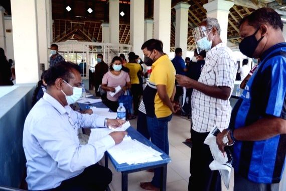 People wait to receive Chinese Sinopharm vaccine amid severe COVID-19 situation in Gampaha, on the outskirts of Colombo, Sri Lanka, May 10, 2021.