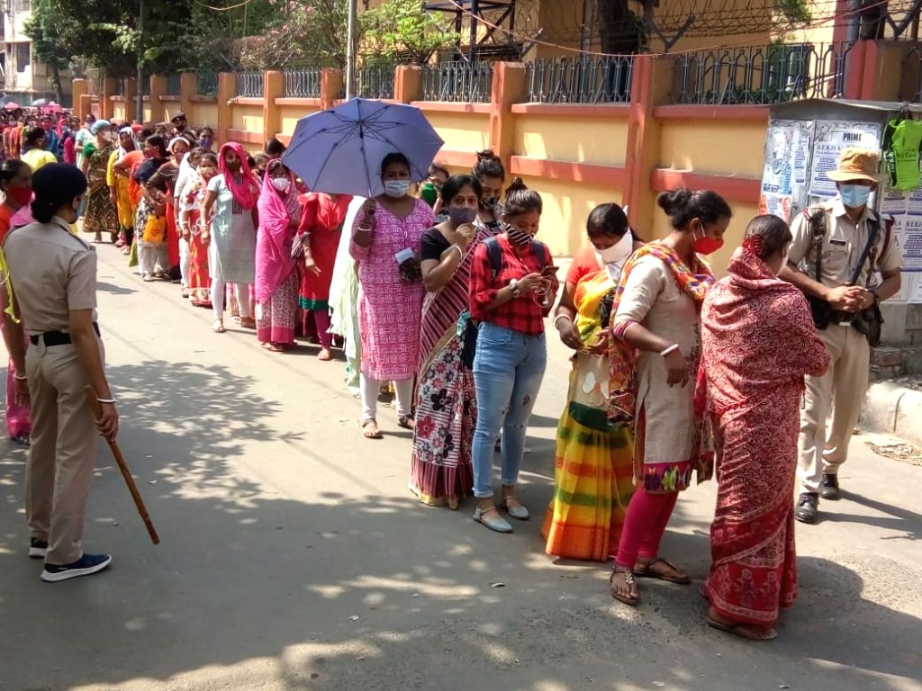 People waiting for casting their votes during 5th phase of West Bengal Assembly election at Bidhannagar in Kolkata on Saturday, 17th April, 2021.