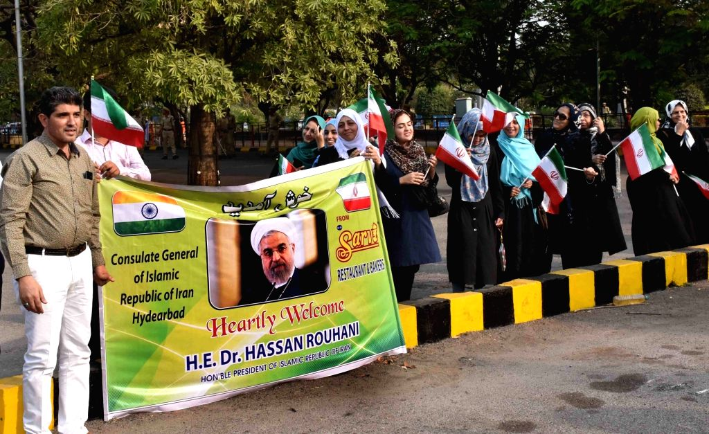 People waiting outside Begumpet Airport to welcome Iranian President Hassan Rouhani, in Hyderabad on Feb 15, 2018. - Hassan Rouhani