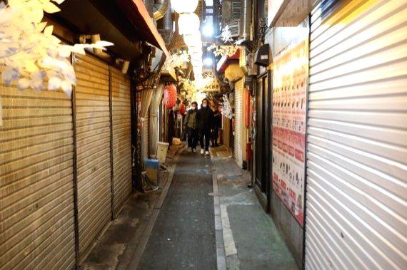 People walk at the sightseeing spot in Asakusa, Tokyo, Japan, Jan. 9, 2021.