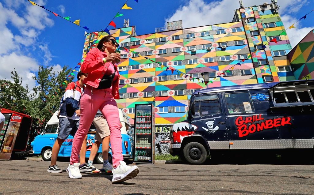 People walk on a street in Minsk, Belarus, Aug. 1, 2020. Belarus reported 138 new confirmed COVID-19 cases on Saturday, taking its total to 67,946, according to the ...
