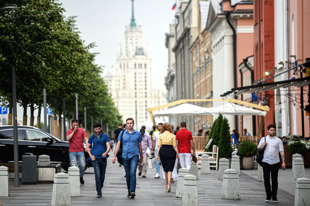 People walk on a street in Moscow, Russia, on July 13, 2020. Russia has registered 6,537 new COVID-19 cases in the last 24 hours, bringing its total to 733,699, the ...