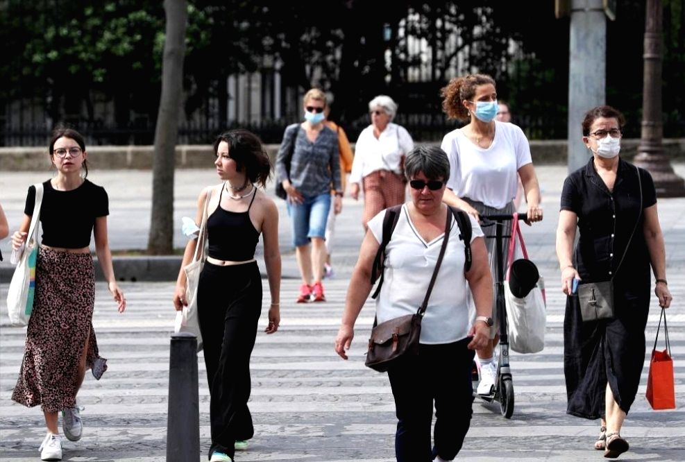 People walk on the Champs Elysees Avenue in Paris, France, June 17, 2021. French Prime Minister Jean Castex on Wednesday announced that people could stop wearing face masks outdoors starting from ... - Jean Castex
