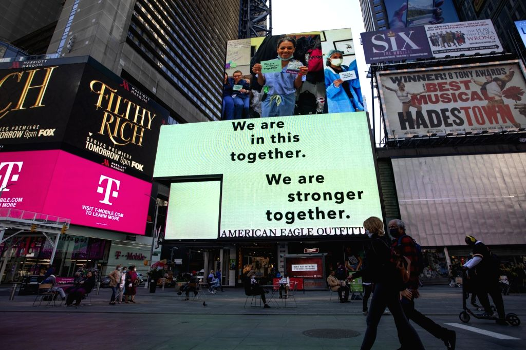 People walk on Times Square in New York, the United States, Sept. 20, 2020. The number of COVID-19 deaths in the United States on Sunday reached 199,474 as of ...