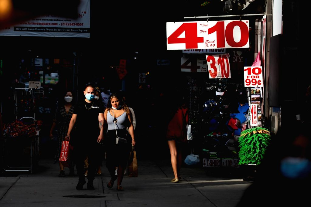 People walk through Times Square during the COVID-19 pandemic in New York, the United States, Sept. 13, 2020. The total number of COVID-19 cases in the United ...