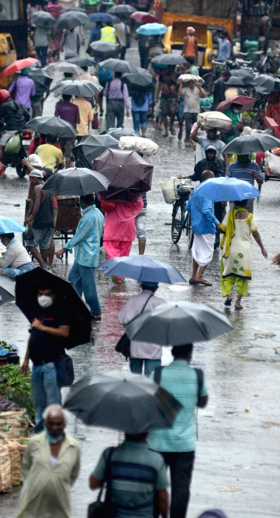 People walking on the road holding umbrella during heavy rain in Kolkata  on Thursday 17 June, 2021.