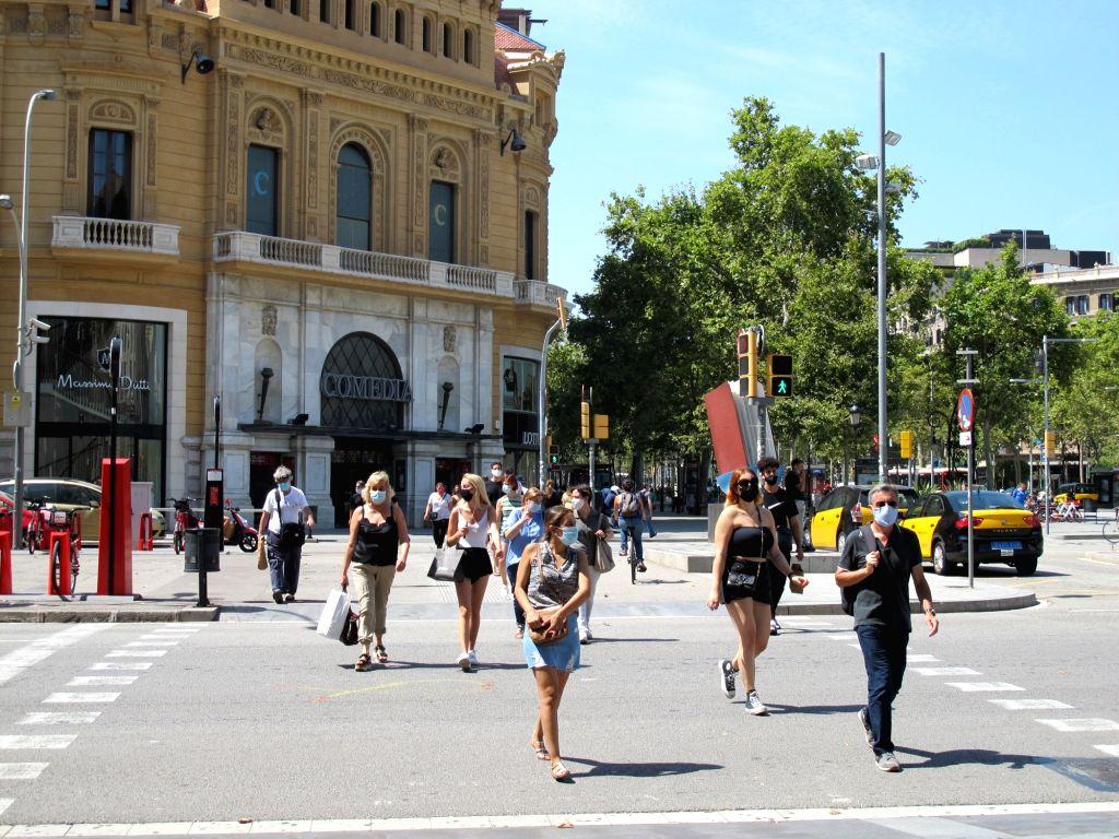 People walks in the center of Barcelona, Spain, July 31, 2020.