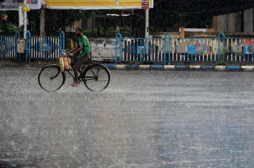 People walks with an umbrella during heavy rain at Salt Lake in Kolkata on Tuesday October 05 ,2021.