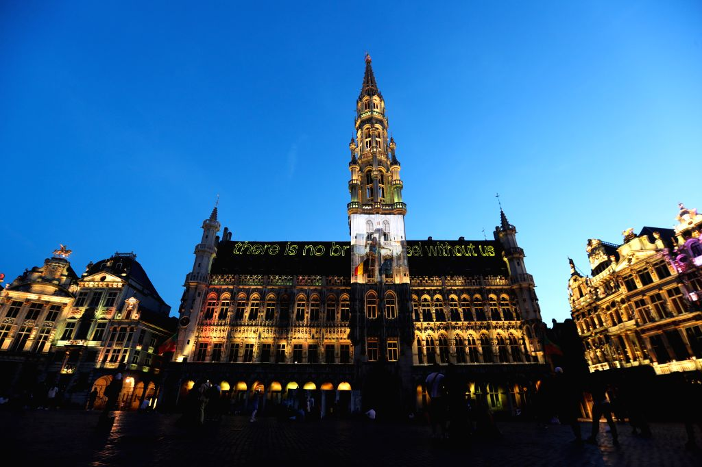 People watch a sound and light show at the Grand Place in Brussels, Belgium, July 29, 2020. A sound and light show was held at the Grand Place of Brussels to ...