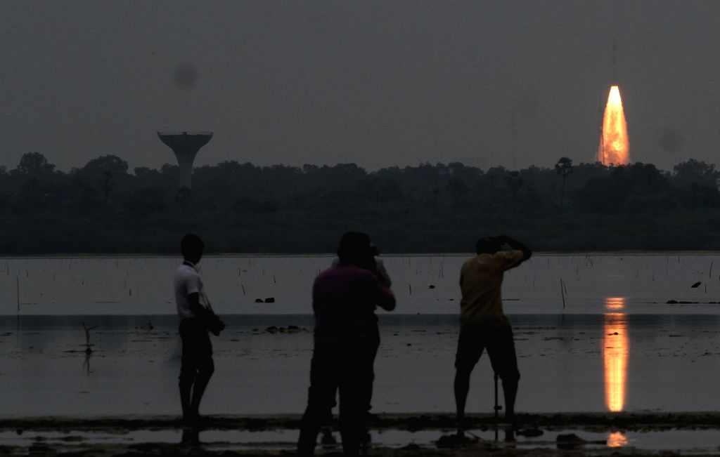 People watch the Polar Satellite Launch Vehicle (PSLV) lift-off from Sriharikota with India's weather satellite SCATSAT-1 on Sep 26, 2016.