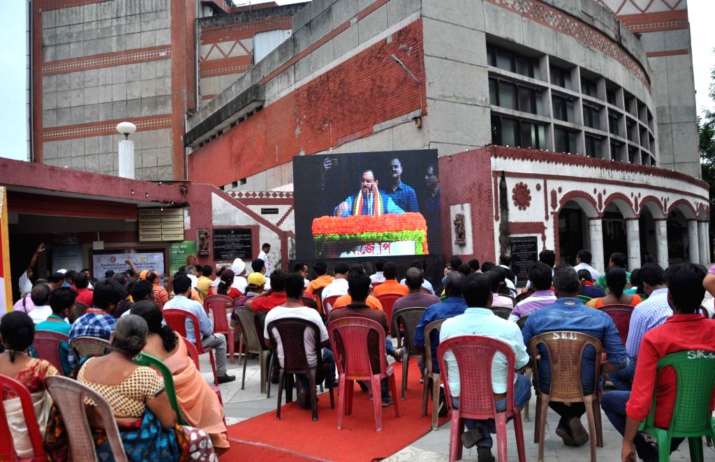 People watch the telecast of BJP National Working President J.P. Nadda's address during 'Jan Jagran' programme on Article 370 in Kolkata, on Sep 27, 2019.
