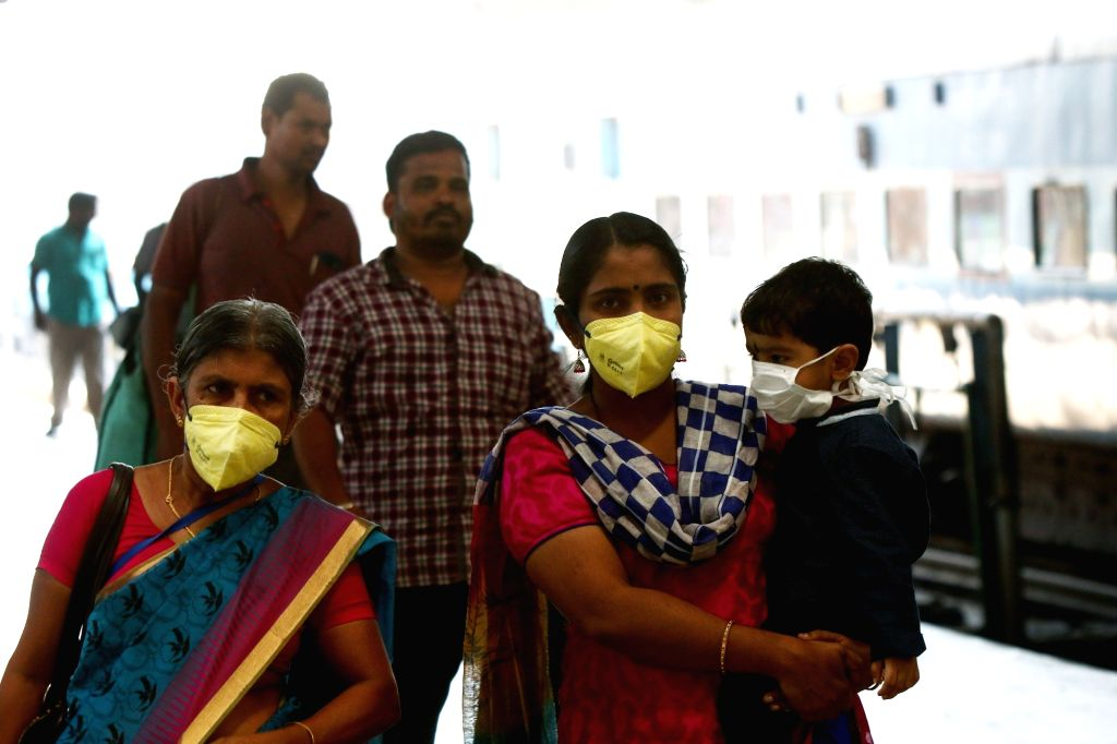 People wear masks as a precautionary measure against COVID-19 (coronavirus) at the Chennai Central Railway Station, on March 17, 2020.