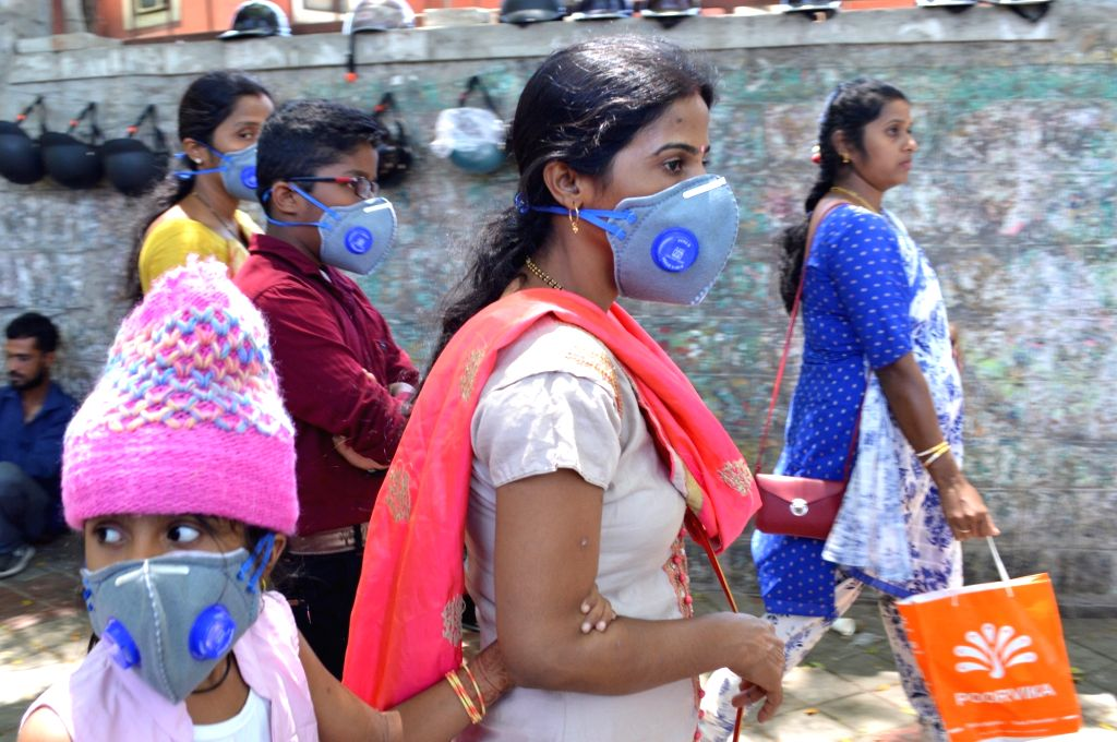 People wear masks as a precautionary measure against COVID-19 (coronavirus) in Bengaluru on March 18, 2020.
