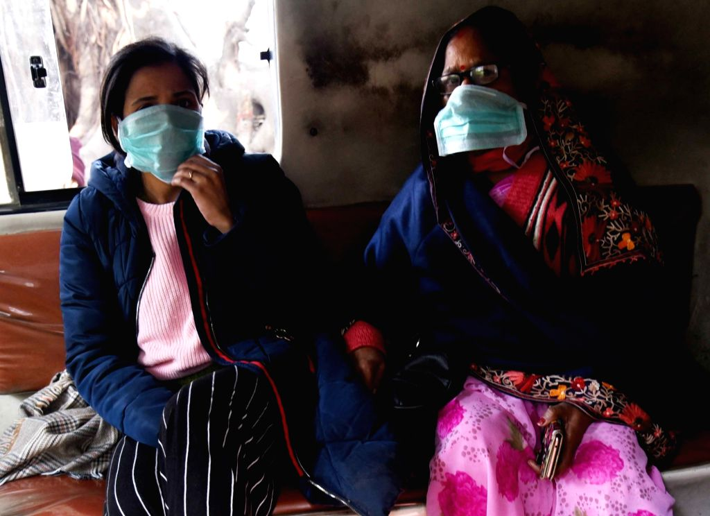 People wear masks as a preventive measure against the novel coronavirus, in Patna on Jan 27, 2020.