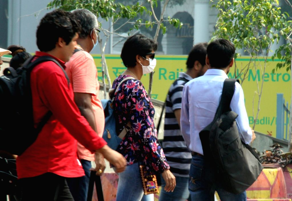 People wear masks to protect themselves from air pollution after the pollution levels in Delhi was found to be two times higher than the safe levels at noon on Oct 16, 2019. The air ...
