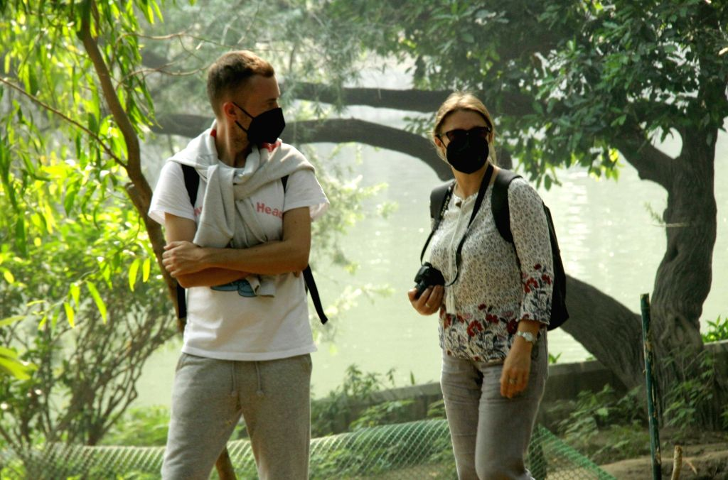 People wear masks to protect themselves from air pollution as toxic haze continues to engulf the national capital, on Nov 13, 2019. The Delhi air quality index (AQI) is at emergency levels ...