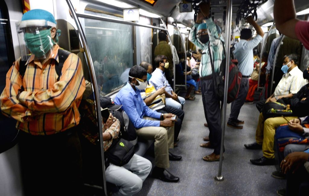 People wearing face masks and face shields travel in a metro amid the COVID-19 pandemic, in Kolkata on Sep 25, 2020.