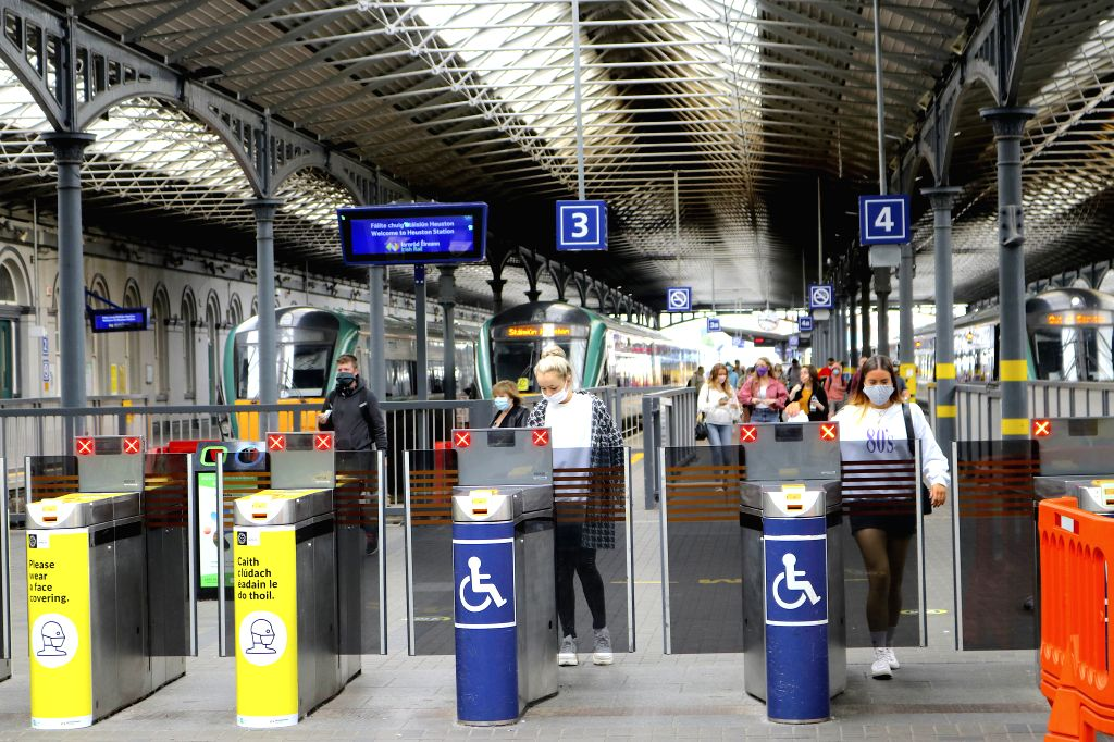 People wearing face masks are seen at a station in Dublin, Ireland, on July 13, 2020. Wearing a mask or face covering on Ireland's public transport is a must ...