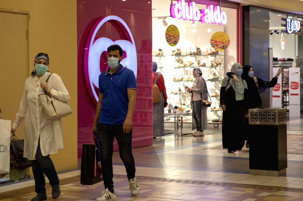 People wearing face masks are seen in a shopping mall in Cairo, Egypt, on Aug. 7, 2020. Egypt registered on Friday 141 new COVID-19 cases, taking the total infections ...