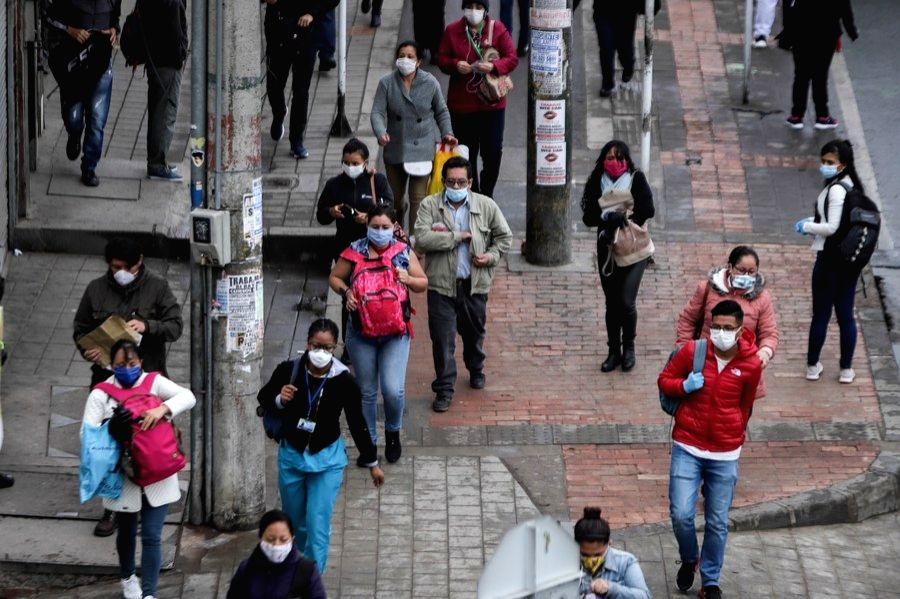 People wearing face masks are seen in Soacha, near Bogota, Colombia, on April 2, 2020.