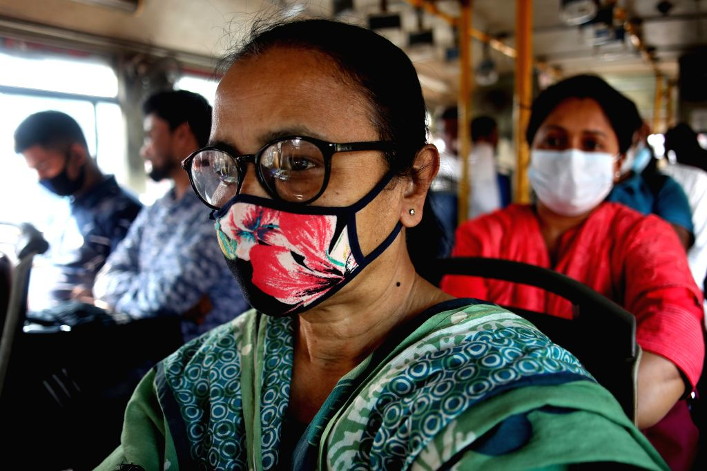 People wearing face masks are seen on a bus in Dhaka, Bangladesh, on March 19, 2020. A total of 17 cases of COVID-19 have been confirmed in Bangladesh with three ...