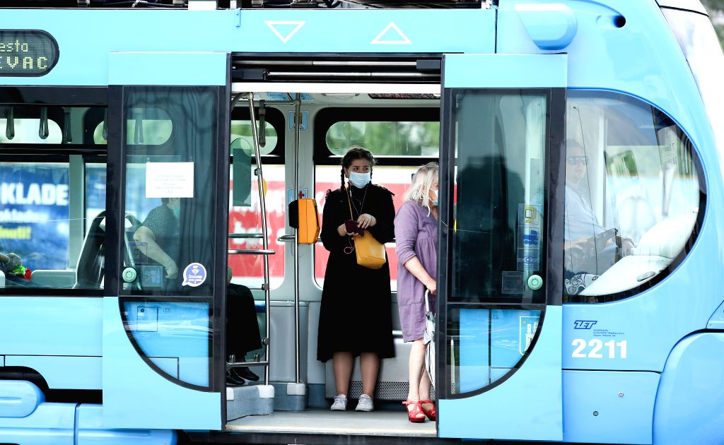 People wearing face masks are seen on a tram in Zagreb, Croatia, on June 25, 2020.