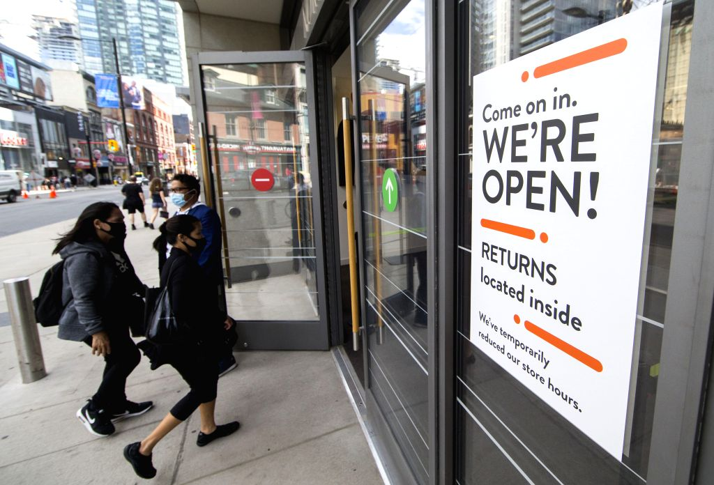 People wearing face masks arrive at CF Toronto Eaton Center in Toronto, Canada, on June 24, 2020. The City of Toronto moved to the next stage of the economic ...