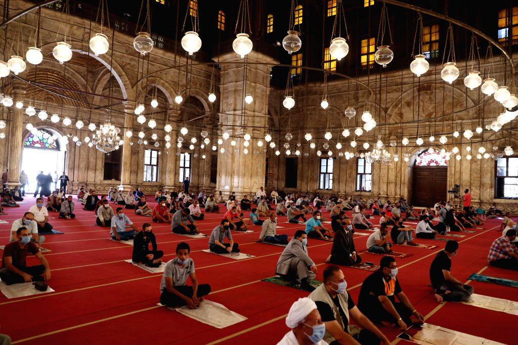 People wearing face masks attend the Friday prayers at Mohamed Ali Mosque in Cairo, Egypt, on Aug. 28, 2020. Egypt registered on Friday 223 new COVID-19 infections, ...