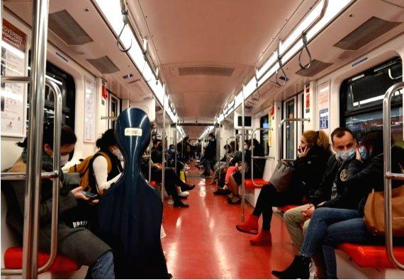People wearing face masks take a subway in Milan, Italy, Oct. 24, 2020.