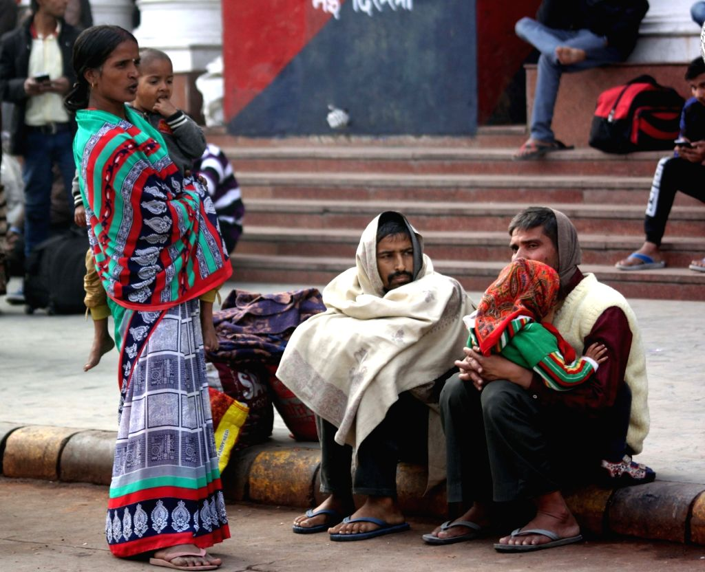 People wearing heavy woolen clothing to protect themselves from cold, at New Delhi Railway station in New Delhi, on Jan 14, 2017. The national capital continues to be in the grip of a cold ...