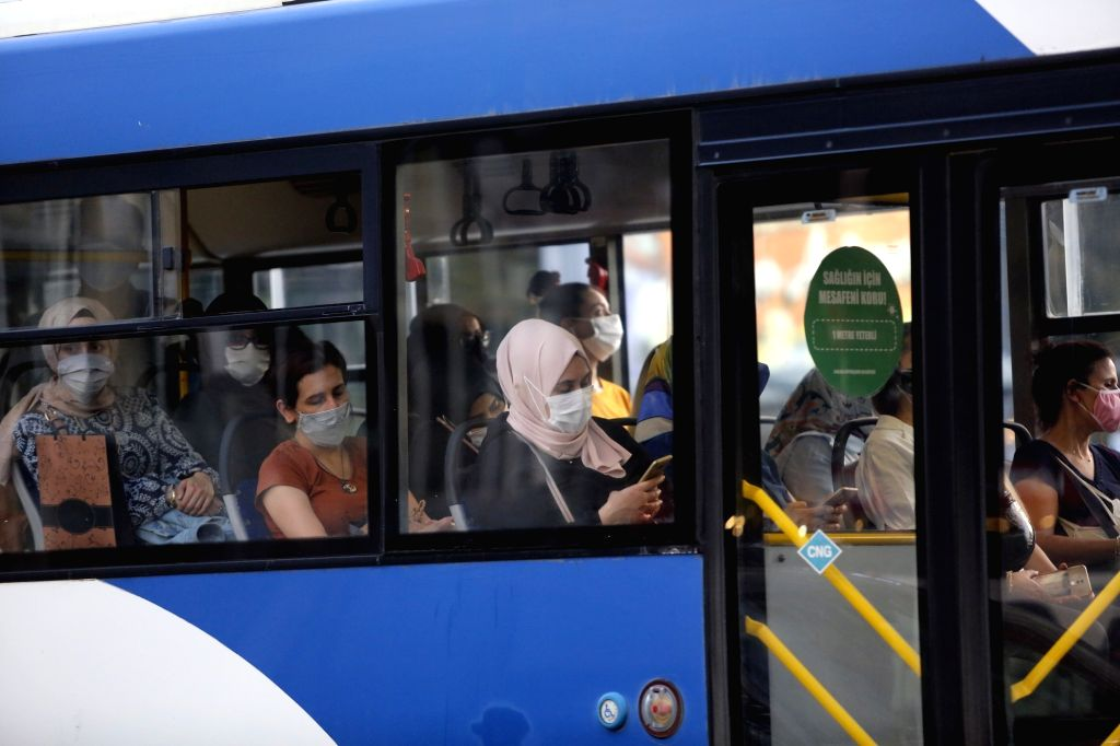 People wearing masks are seen on a bus in Ankara, Turkey, on Sept. 11, 2020. Turkey confirmed 1,671 new COVID-19 cases on Friday, raising the total diagnosed ...