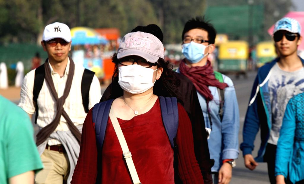 People wearing masks as a precautionary measure against swine flu. (File Photo: IANS)