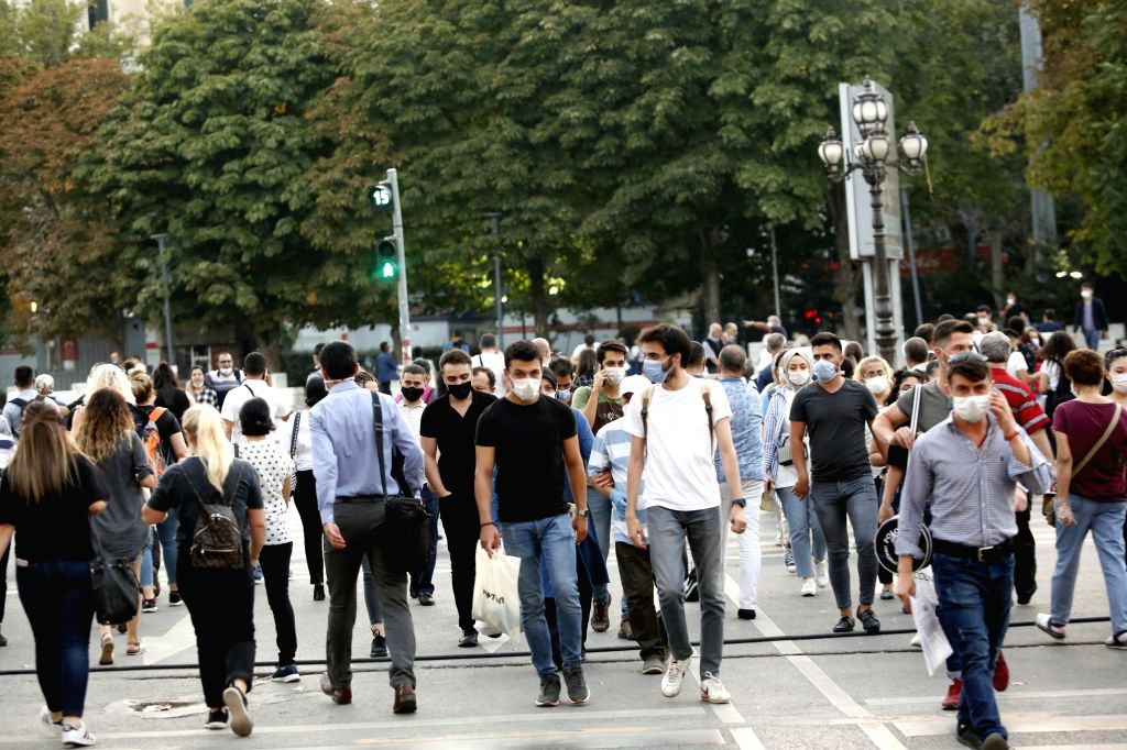 People wearing masks cross a street in Ankara, Turkey, on Sept. 11, 2020. Turkey confirmed 1,671 new COVID-19 cases on Friday, raising the total diagnosed patients ...