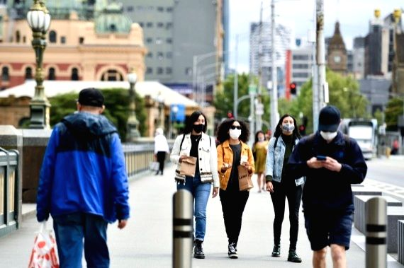 People wearing masks walk in CBD of Melbourne, Victoria, Australia, on Oct. 19, 2020.