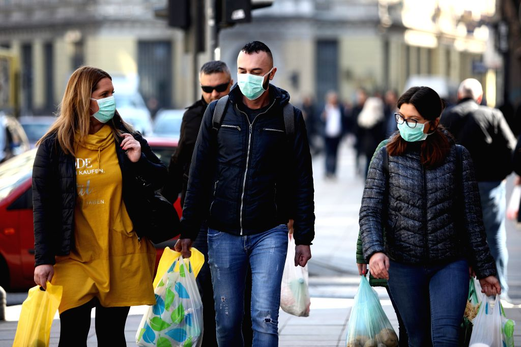 People wearing masks walk on a street in Sarajevo, Bosnia and Herzegovina (BiH) on March 18, 2020. Bosnia and Herzegovina (BiH) declared a state of emergency on ...