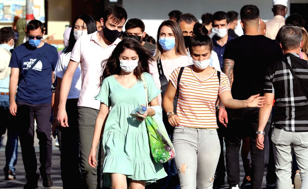People wearing masks walk on the street in Ankara, Turkey on Sept. 18, 2020. Turkey's confirmed COVID-19 cases increased by 1,771 on Friday, raising the total ...