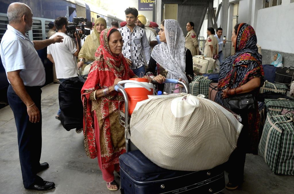 People who had gone to Pakistan arrive at Attari international railway station after cutting short their tour following escalated tension between India and Pakistan on Oct 2, 2016.