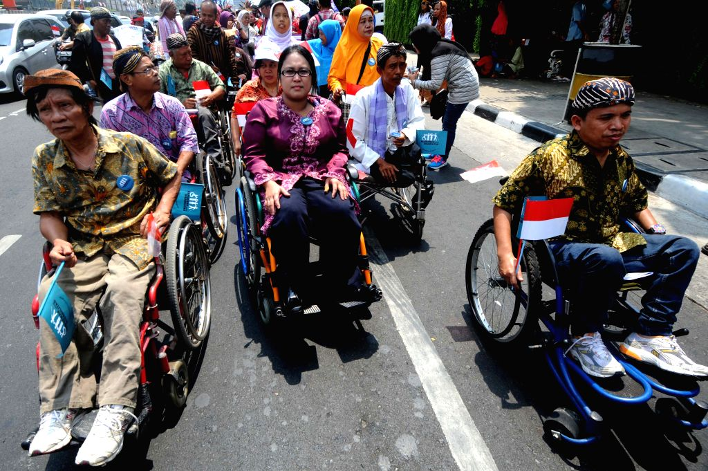 People with disabilities in Indonesia participate in a cultural carnival as during this activity they can access health, education and other public services, and ...