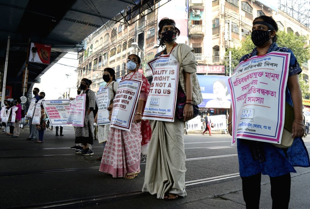 People with disabilities participate in a silent demonstration to protest against inequality, discrimination and violence meted out to people with disabilities, on the occasion of ...