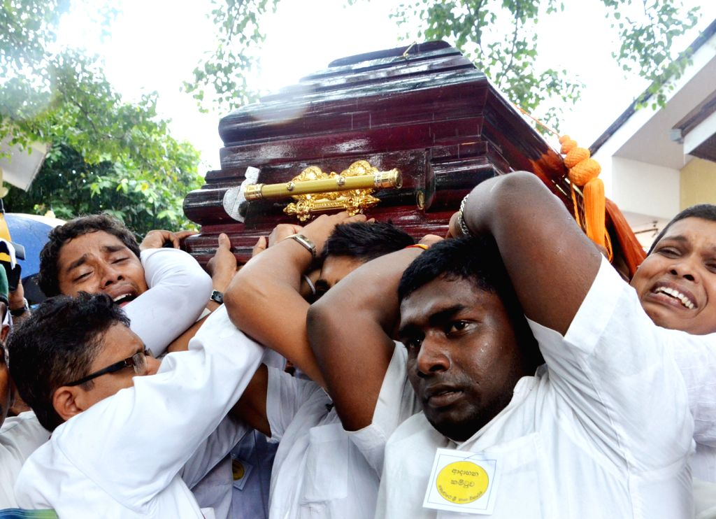 People with sadness carry the coffin of the Venerable Maduluwawe Sobitha Thero, an influential Sri Lankan Buddhist monk in Colombo, Sri Lanka, Nov. 12, 2015. ...