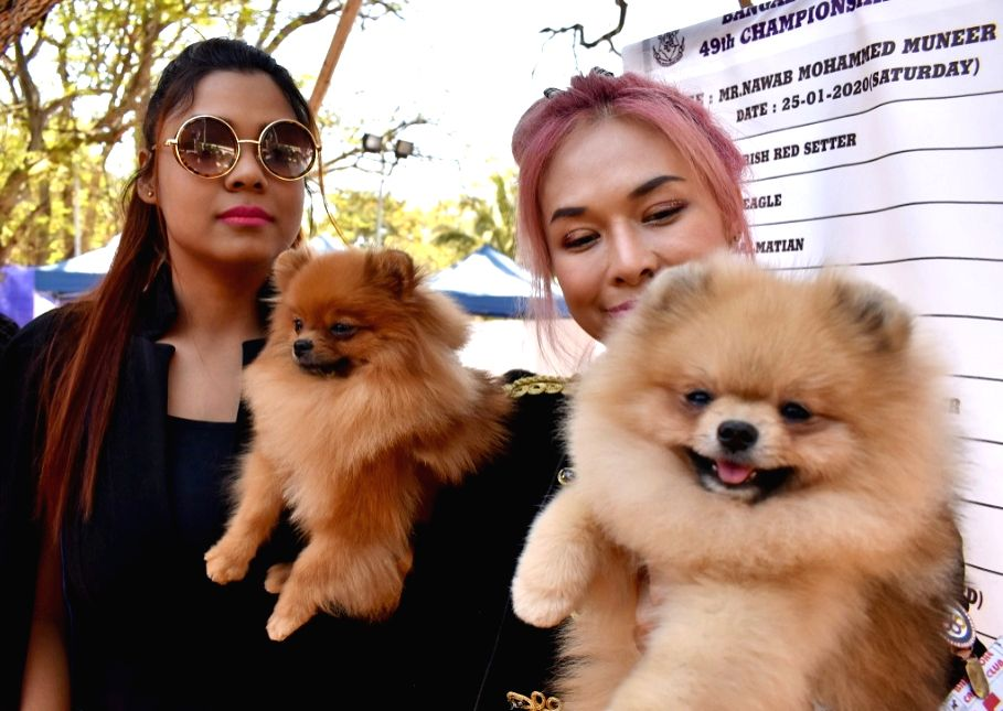 People with their pet dogs during the 50th Dog Show at Bangalore Canine Club in Bengaluru on Jan 25, 2020.