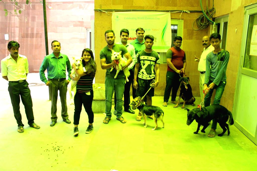 People with their pets at a free animal vaccination camp setup by Indian Immunologicals Ltd on Zoonosis Day in New Delhi, on July 6, 2018.