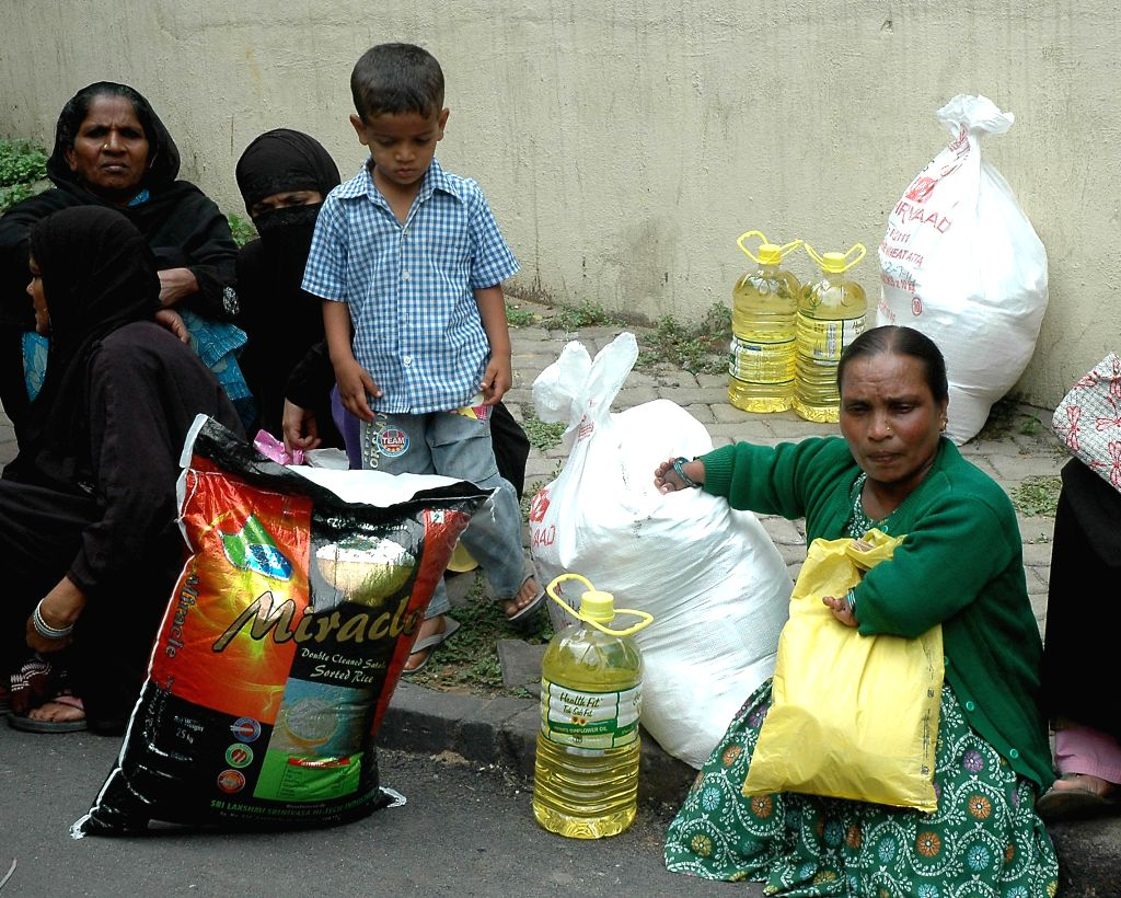 People with `Zakaat` during Ramadaan in Bangalore on July 16, 2014.