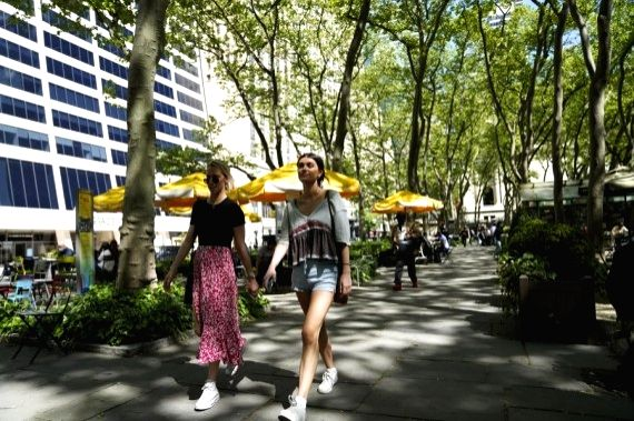 People without mask walk through Bryant Park in New York, the United States, May 14, 2021.