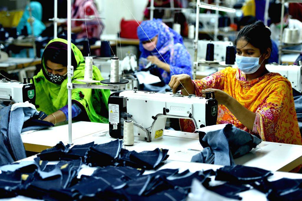 People work at a garment factory in Dhaka, Bangladesh, on Aug. 12, 2020. Bangladesh's July export income was over 44 percent higher than that in June, meaning the ...