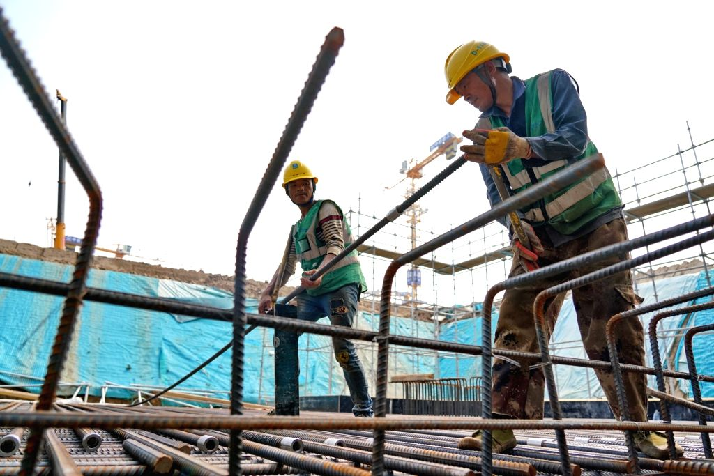 People work at the construction site of Rongdong area, a 13-sq-km residential area that is expected to be home to 170,000 people, in Xiongan New Area, north China's ...