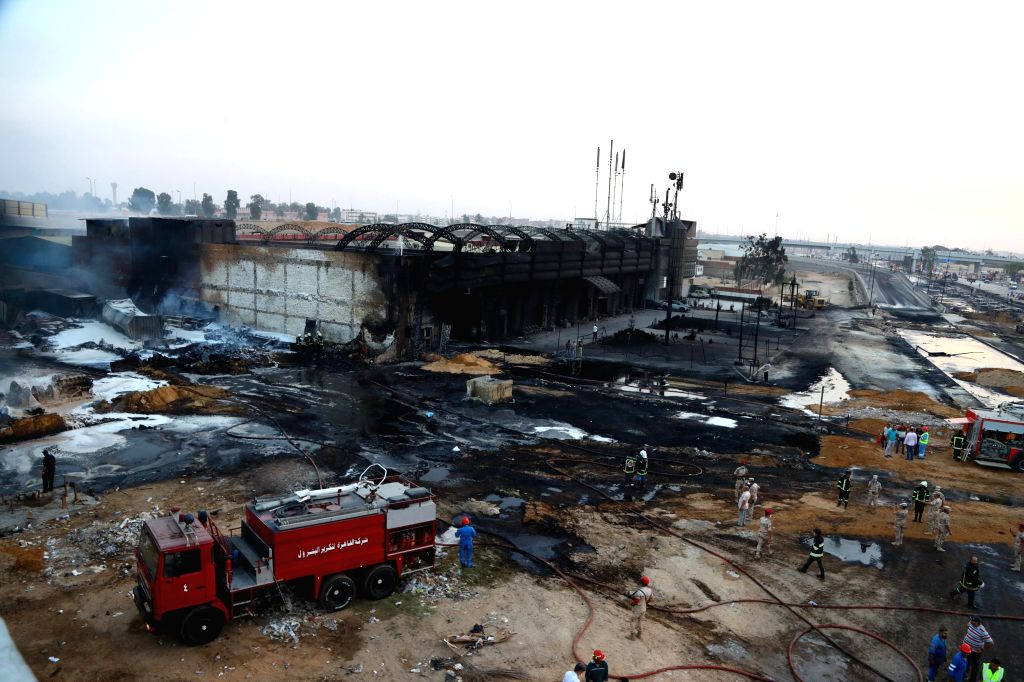 People work at the site of a crude oil pipeline fire in Cairo, Egypt, on July 14, 2020. A dozen of people were injured on Tuesday in a crude oil pipeline fire in the ...